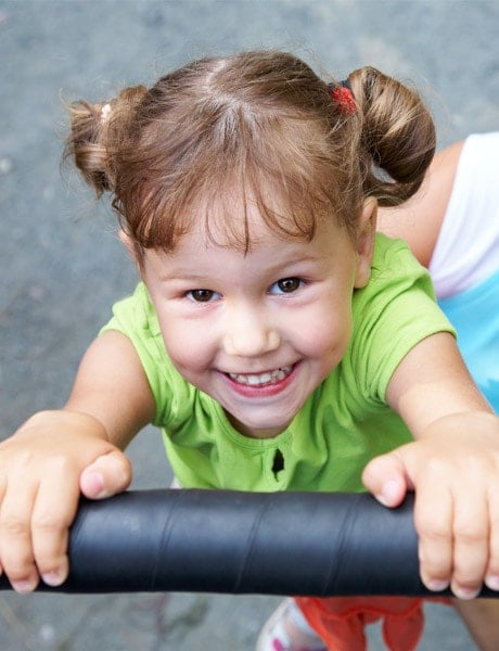 Girl playing on equipment